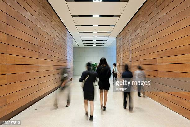 Business people moving along the corridor