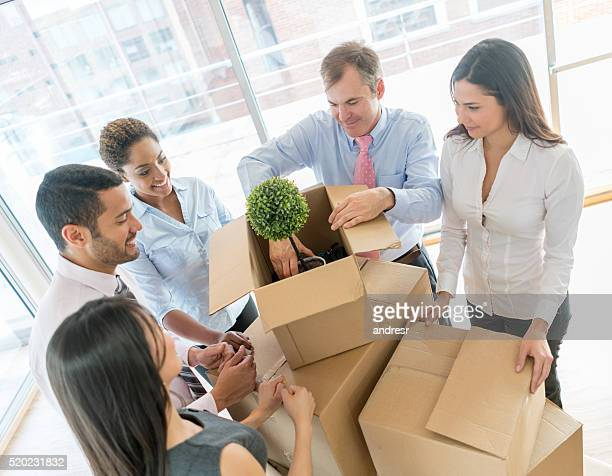 Business people moving and packing in boxes