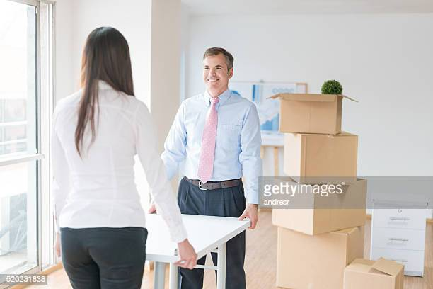 business people moving to a new office - picking up stock photos and pictures