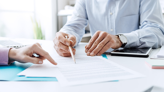 Business people negotiating a contract 586750982