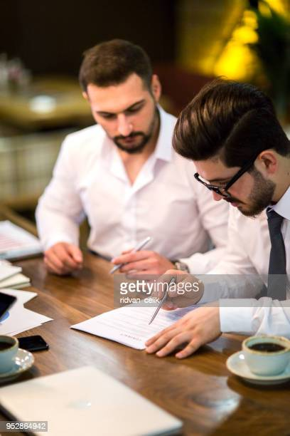 business people negotiating a contract. - employment law stock photos and pictures