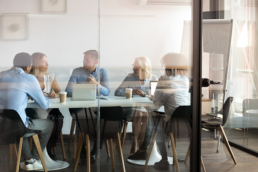 Business people negotiating at boardroom behind closed doors 1127397327