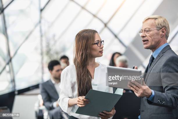 Business People on a Conference Event Discussing