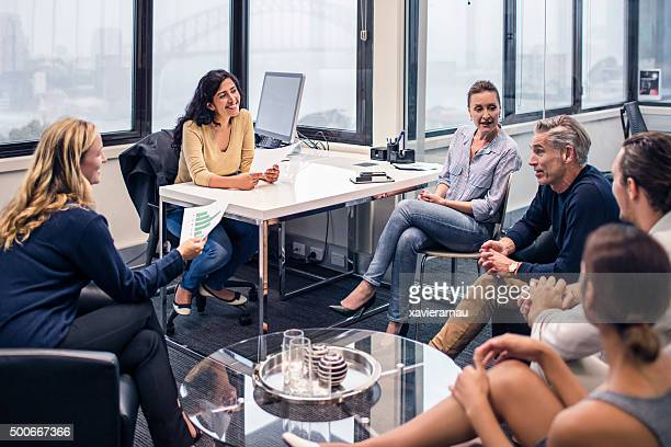 business people on a meeting in the office - customs stock pictures, royalty-free photos & images