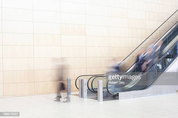 business people on escalators - escalator stock pictures, royalty-free photos & images
