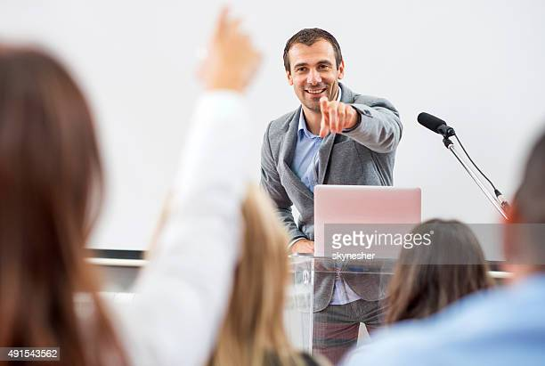 business people on seminar. - presenter stock pictures, royalty-free photos & images