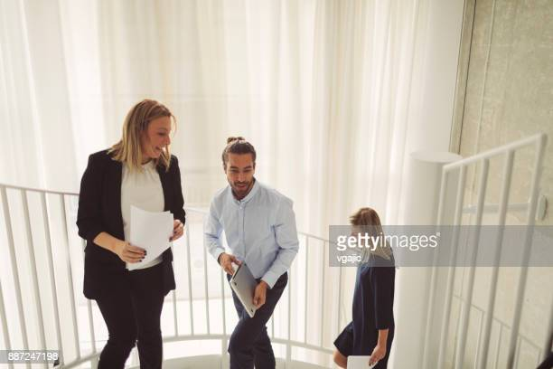 Business people on Staircase In Modern Office