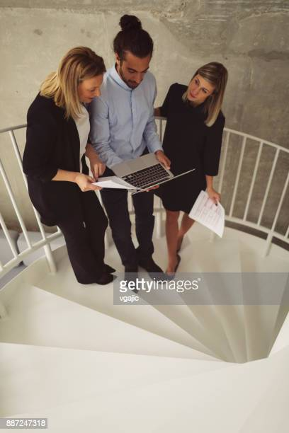 business people standing stairs modern office