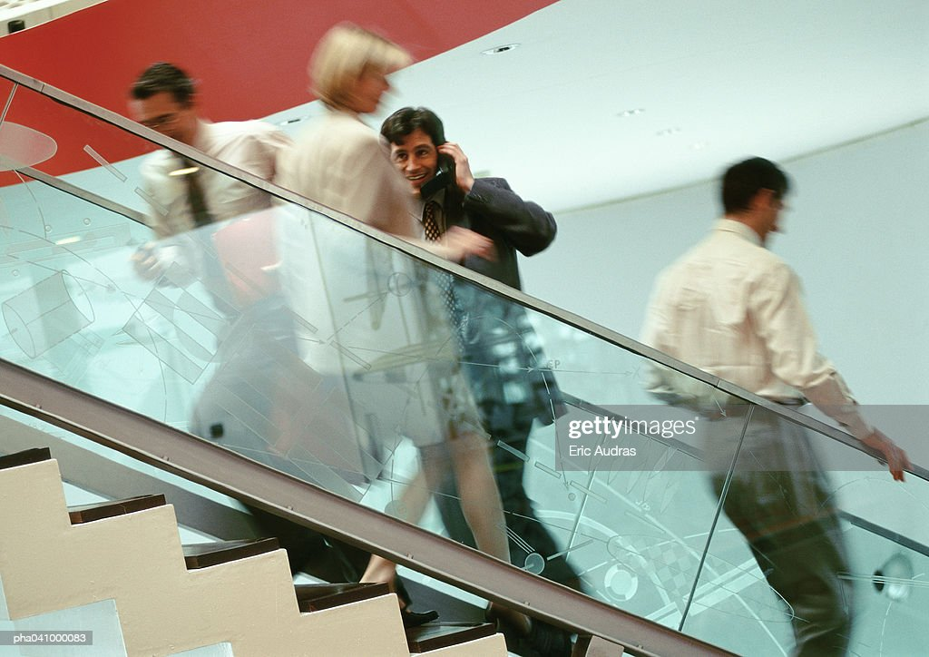Business people on stairs, blurred : Stockfoto