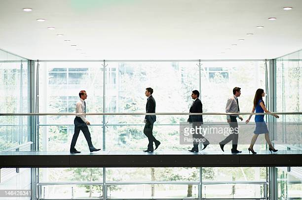 business people on the move - elevated walkway stock pictures, royalty-free photos & images