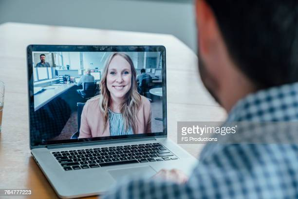 business people on video conference - video conference stock pictures, royalty-free photos & images