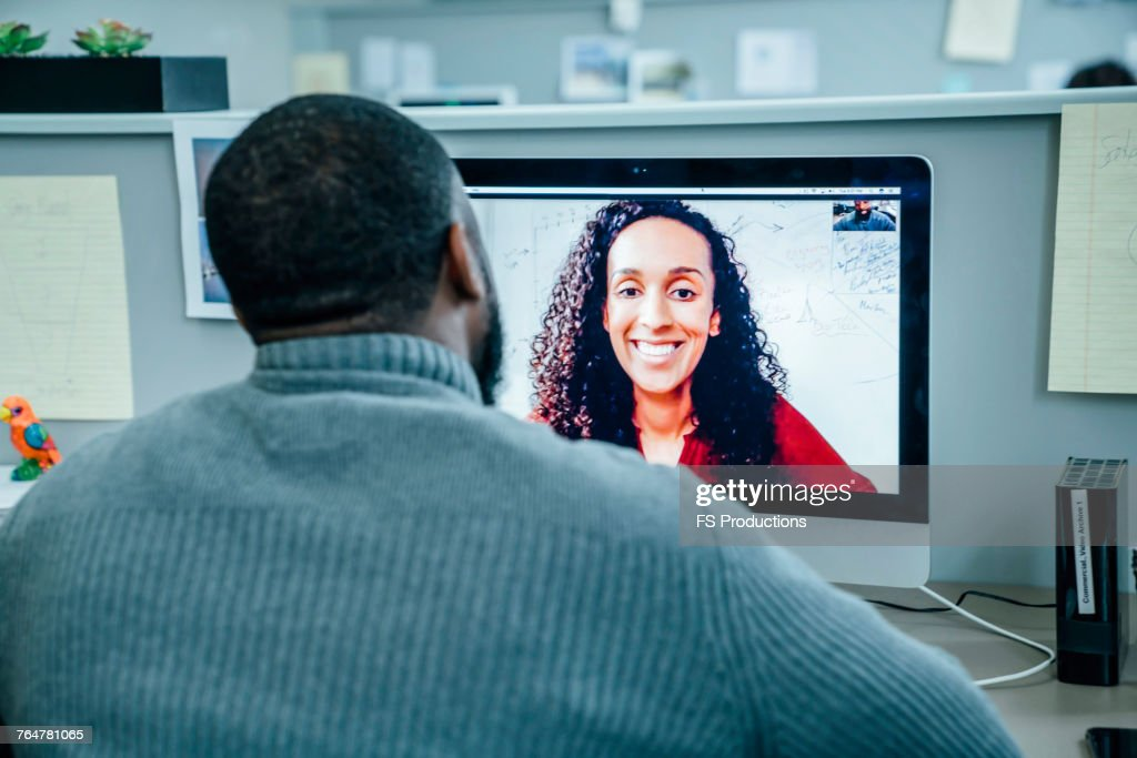 Business people on videoconference : Stock Photo