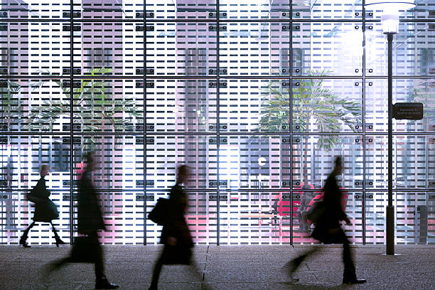 Business people passing modern office building