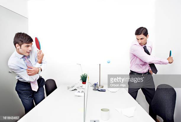 business people playing table tennis - funny ping pong stock pictures, royalty-free photos & images