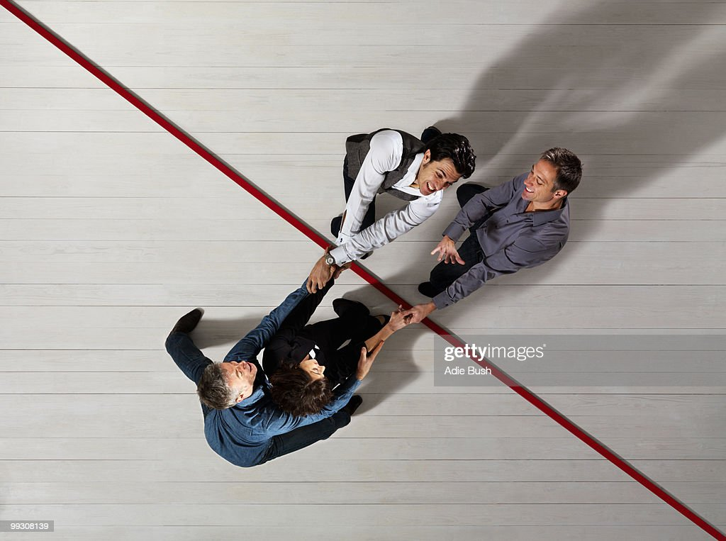 Business people pulling each other : Stock Photo