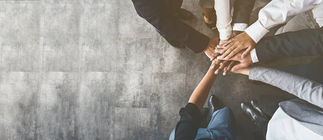 Business people putting their hands together, top view 1133819402