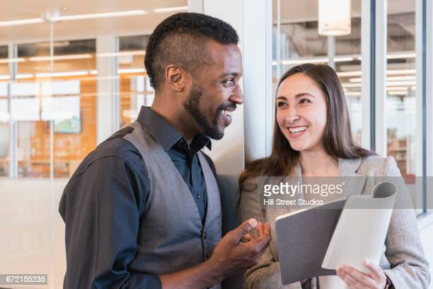 Business people reading notebook in office