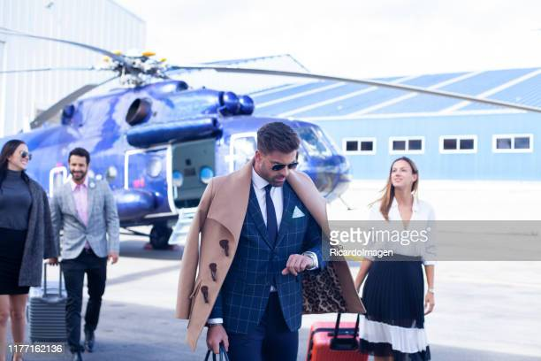 business people ready to travel by helicopter - helicopter stock pictures, royalty-free photos & images