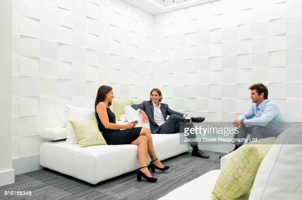 Business people relaxing in modern lounge