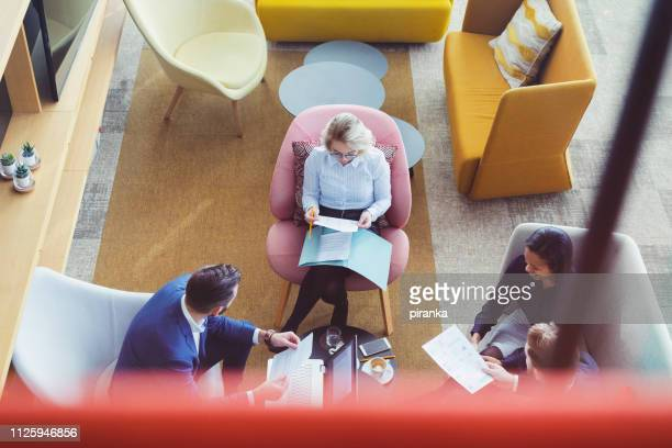 business people relaxing - coworking stock photos and pictures