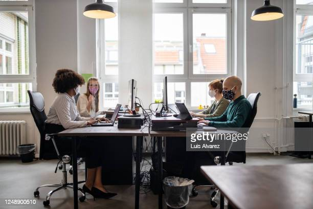 business people return back to work after covid-19 pandemic - employee stock pictures, royalty-free photos & images