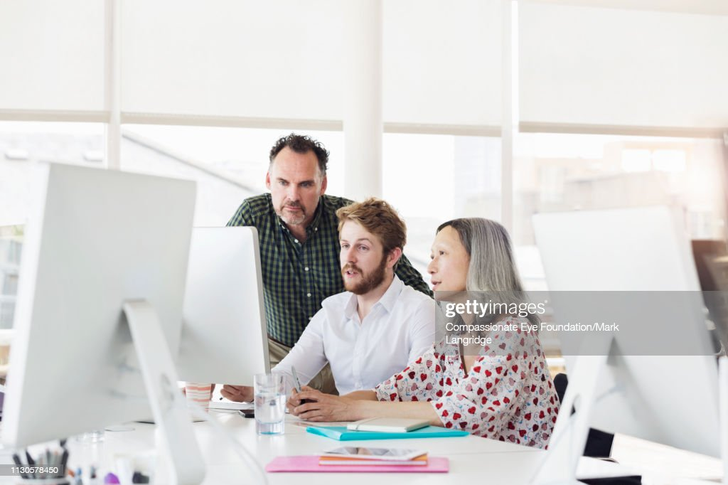 Business people reviewing project in modern office : Stock Photo