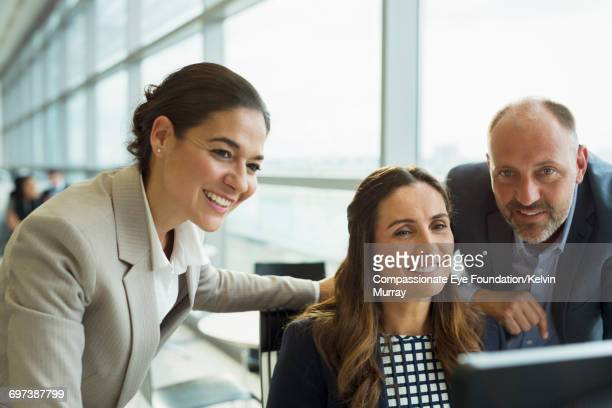 Business people reviewing project in office