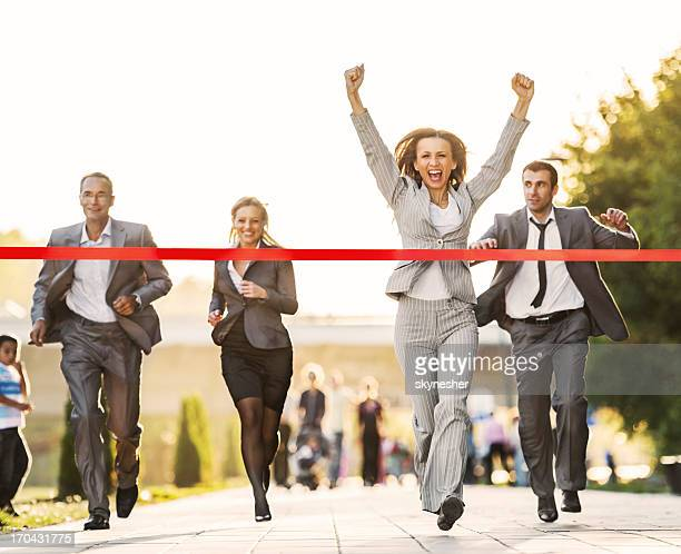 business people running to finish, crossing red line. - rivaliteit stockfoto's en -beelden