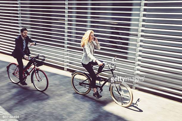 Business People Rushing to Work on a Bicycle