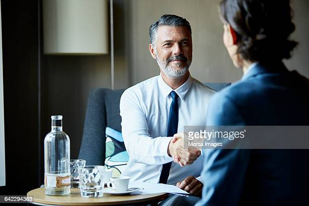 Business people shacking hands after meeting