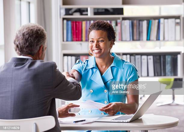 business people shaking hands at desk - recruitment stock pictures, royalty-free photos & images