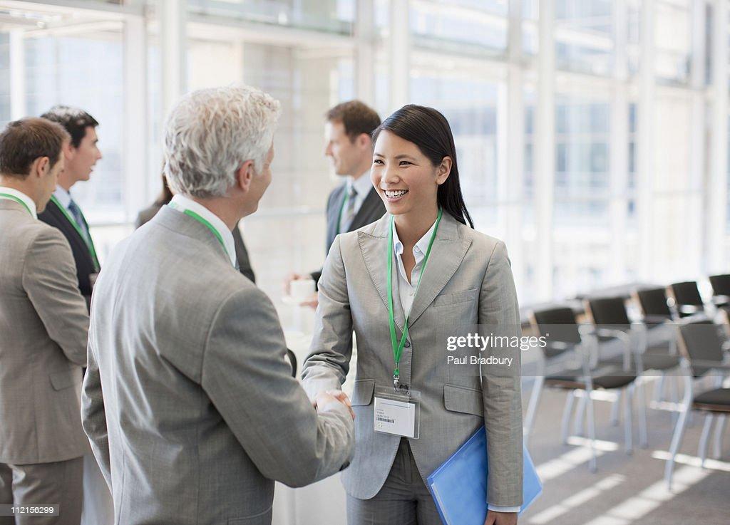 Business people shaking hands at seminar : Stock Photo