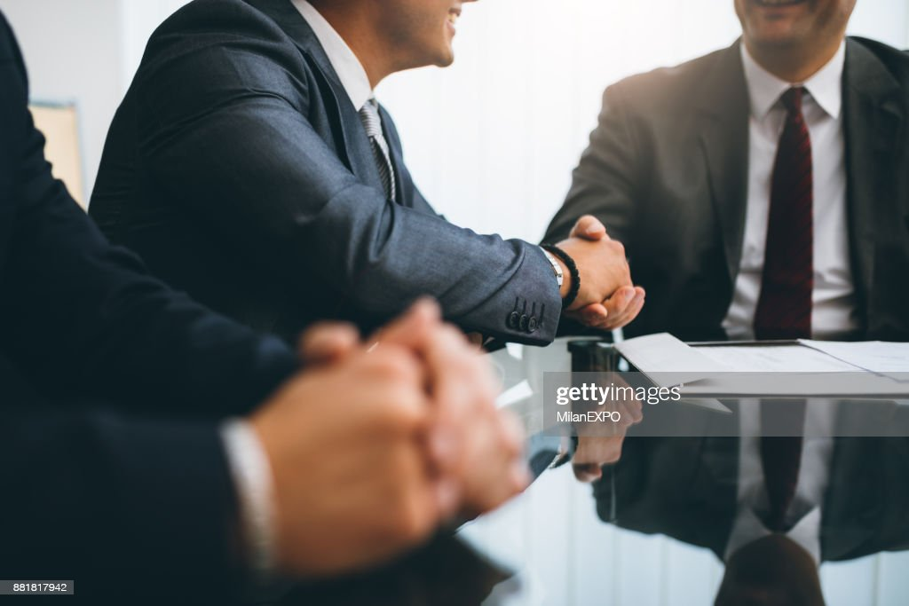 Business people shaking hands, finishing up a meeting : Stock Photo