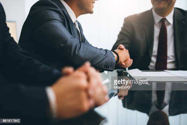 business people shaking hands, finishing up a meeting - agreement stock pictures, royalty-free photos & images
