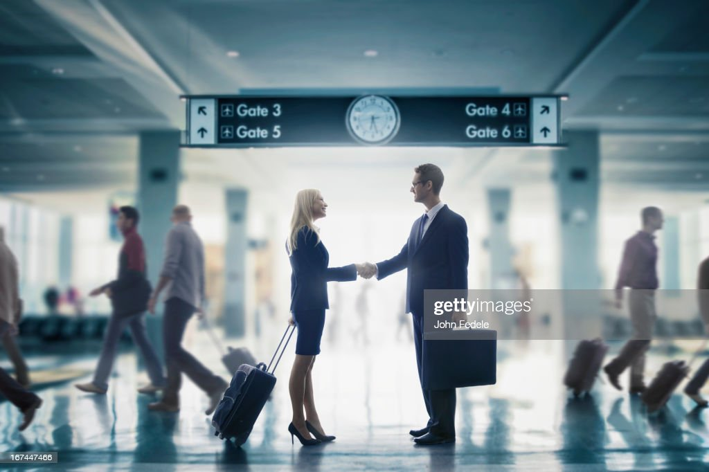 Business people shaking hands in airport : Stock Photo