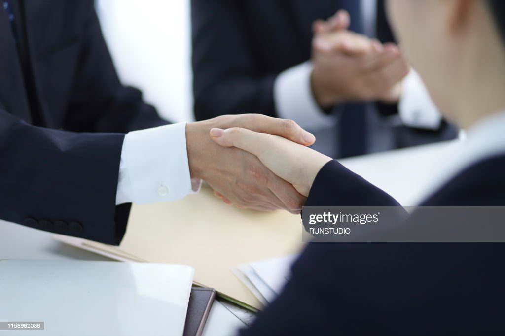 Business people shaking hands in meeting : ストックフォト