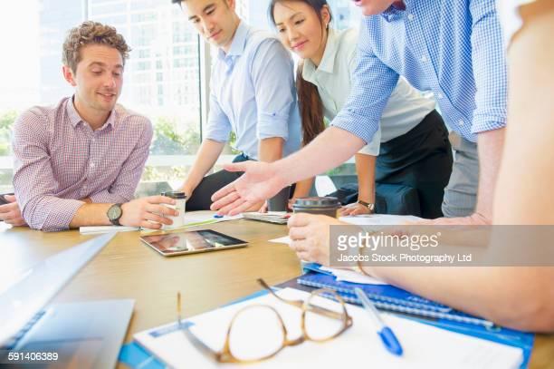 business people shaking hands in office meeting - mittlerer teil stock-fotos und bilder