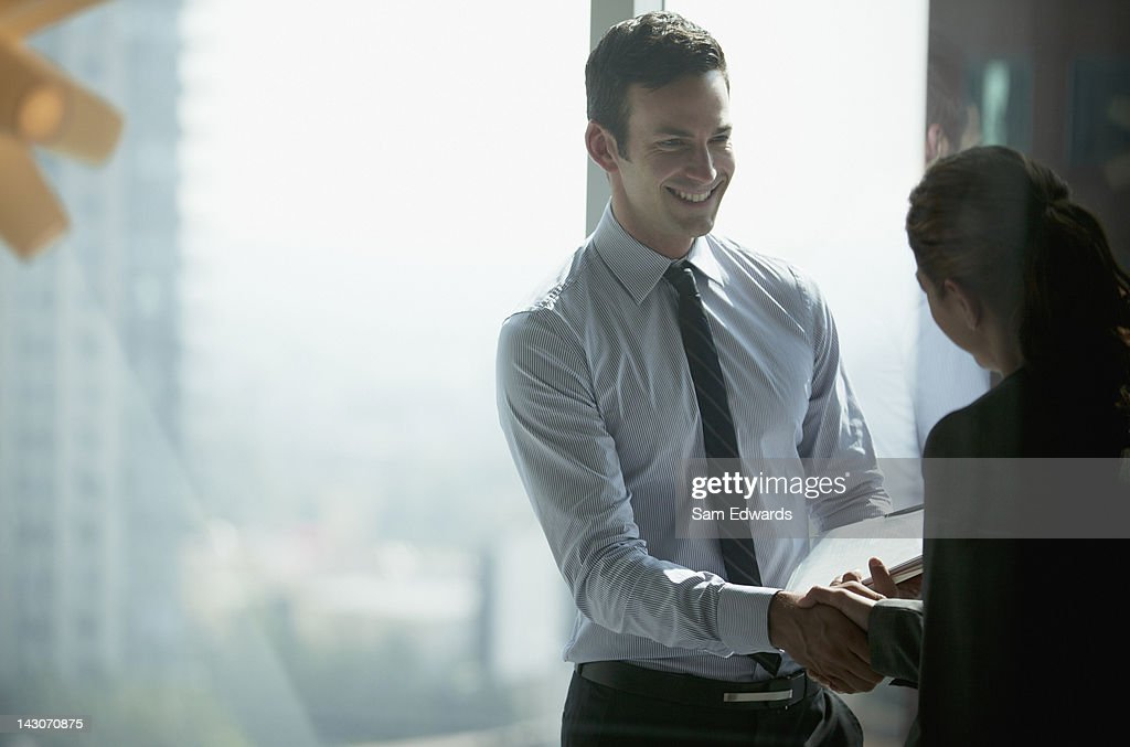 Business people shaking hands in office : Stock Photo