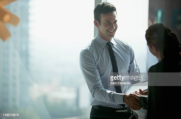 business people shaking hands in office - finishing stock pictures, royalty-free photos & images
