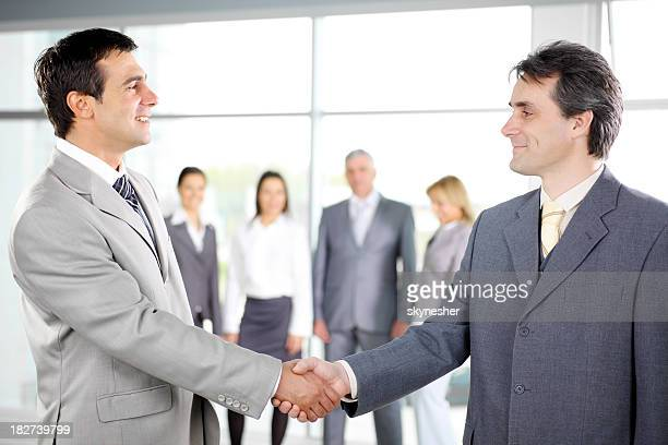 business people shaking hands on meeting in the office. - gray suit stock pictures, royalty-free photos & images