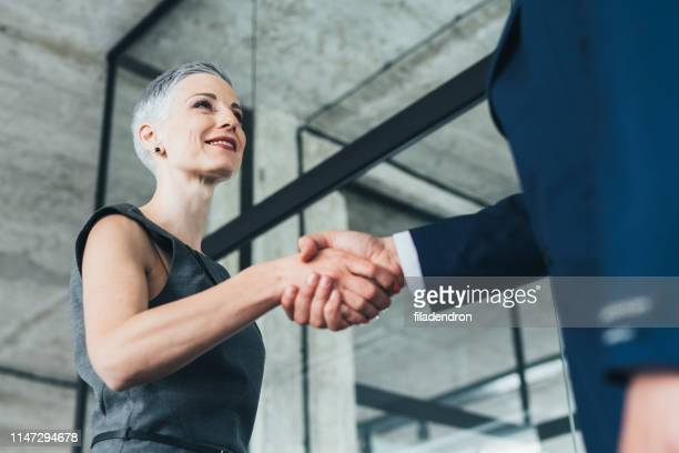 business people shaking hands - employee appreciation stock pictures, royalty-free photos & images