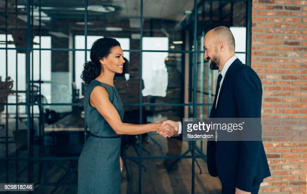 business people shaking hands - human relationship stock pictures, royalty-free photos & images
