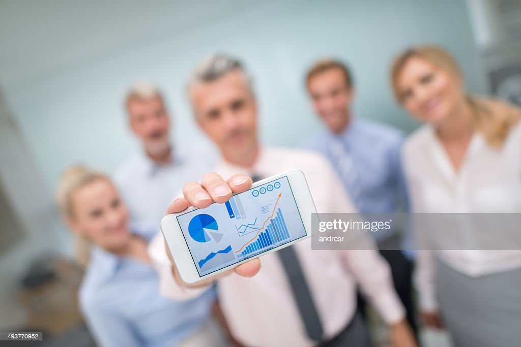 Business people showing online growth development : Stock Photo
