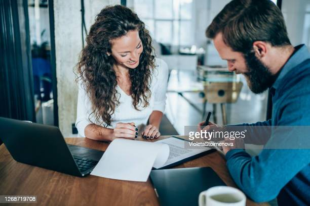 business people signing a contract. - contract stock pictures, royalty-free photos & images