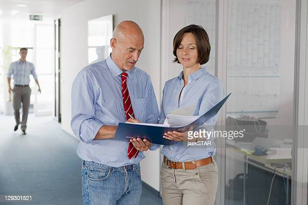 Business people signing papers in office
