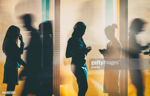 business people silhouettes - shadow forms stock photos and pictures