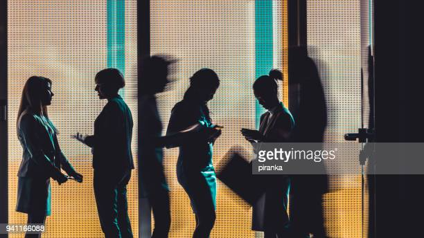 business people silhouettes - motion blur stock photos and pictures