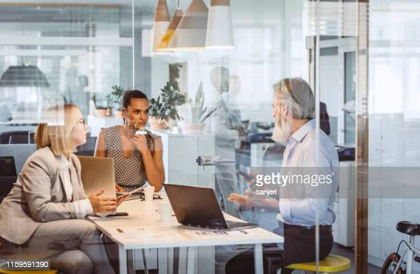 business people sitting at desk, discussing - big tech stock pictures, royalty-free photos & images