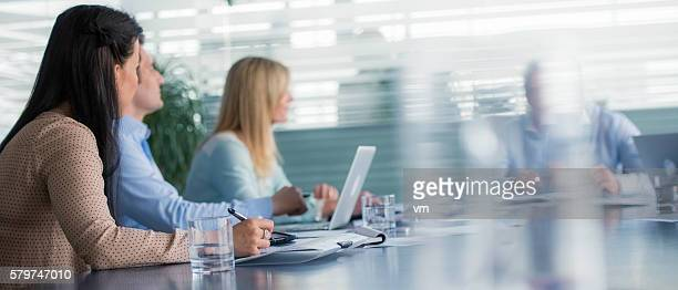 Business people sitting at the conference table during a meeting