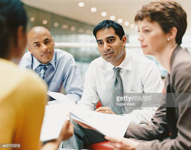 Business People Sitting in an Office Building Chatting